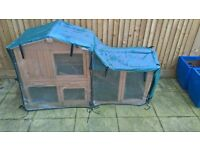 rabbit hutch and weather protector