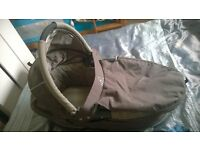 brown and blue quinny carry cot