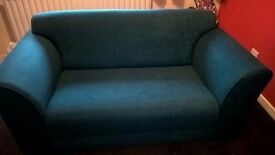 two identical teal small sofas price is for both..must go as we move on friday!!