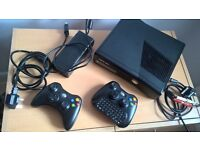 Xbox 360, 250gb with 2 wireless controllers and chatpad.