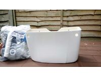 Brand new, low-level cistern including fixtures (no lid)
