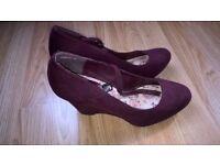 Purple heel shoes