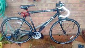 Redemption X Road 960 Gents Bike 14 speed. 6 months old, matt black 56cm.