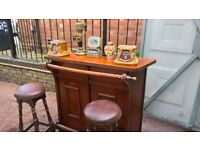 Novelty pub bar for mancave with display wall cupboard