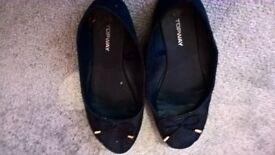 well worn navy ballerina flat shoes