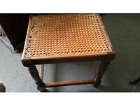 Antique stool with reed mesh seat and wooden legs