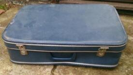 Small blue vintage suitcase.