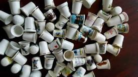 Around 60 ceramic thimbles