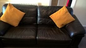 Real leather 2 and 3 seat sofas and leather pouffe with storage.REDUCED