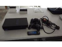 PS2 Console, 2 controlles & remote + 5 Games