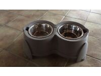 Used double raised dog bowl
