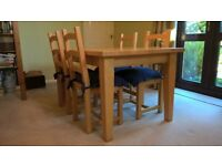 Solid light wood dining table and four chairs - fab condition
