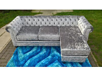 A Stunning New Hampton 3 Seater Grey Crushed Velvet Buttoned Back Lounger.