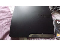 ps3 slim consone with leads and wireless after glow controller
