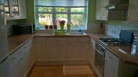 Complete kitchen including units, work surfaces, oven, hob and extractor £395