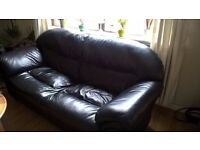 Great condition black leather three seater sofa