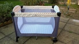 Travel cot, bassinette, changing mat and carry case. Boxed with instructions