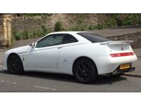 Alfa GTV V6 3.0 24v. White with tan leather interior. Looks and drives superb. Very reluctant sale.