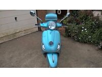 Vespa 50cc scooter (2011), blue, with topbox
