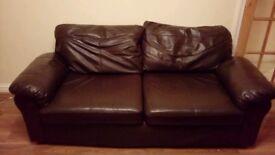 Free 3 seater brown faux leather sofa. Dimensions approx W 190cm D 90cm H 80cm. Detachable cushions