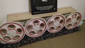 Porsche alloys refurbished to new. These sell a lot more on sites such as eBay. Do your research.