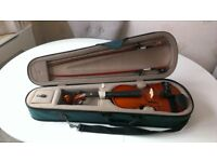 Half Size Child's Violin with case and excessories. Good condition