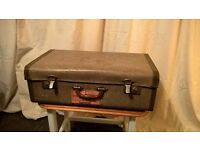 Vintage suitcase with interesting travel label
