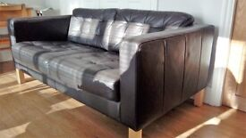 two seater dark brown leather 2 seater sofa.