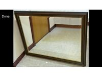 Large mirror with dark wood frame