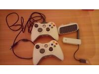 X2 xbox 360 controllers, x1 charging cable , x1 wifi adapter aerial, x1 messenger keypad