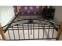 Pretty wood and metal double bed with filial detail