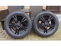 black alloy wheels with tyres .never used.215/60/16 five stud