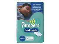Pampers bed mats 3 packs of 7. 21 mats total.