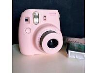 Fuji film Pink Instax Mini 8 Polaroid Camera with approx. 28 polaroid shots.