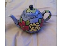 Hand painted teapot by fleshpots of England.