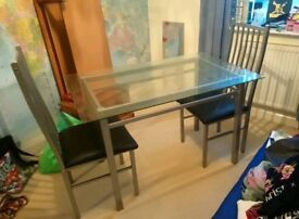 GLASS TOP DINING TABLE AND TWO CHAIRS