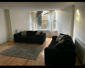 2 x 3 seater black fabric sofa beds- £350