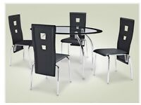 Glass oval black dining room table and 4 faux leather chairs