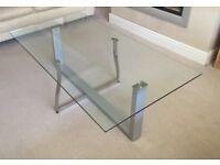 Ultra modern glass top metal frame coffee table