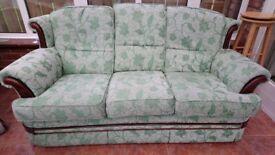 Three seater settee in green