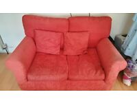 2 seat red sofa