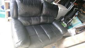 Two seater black leather reclining sofa