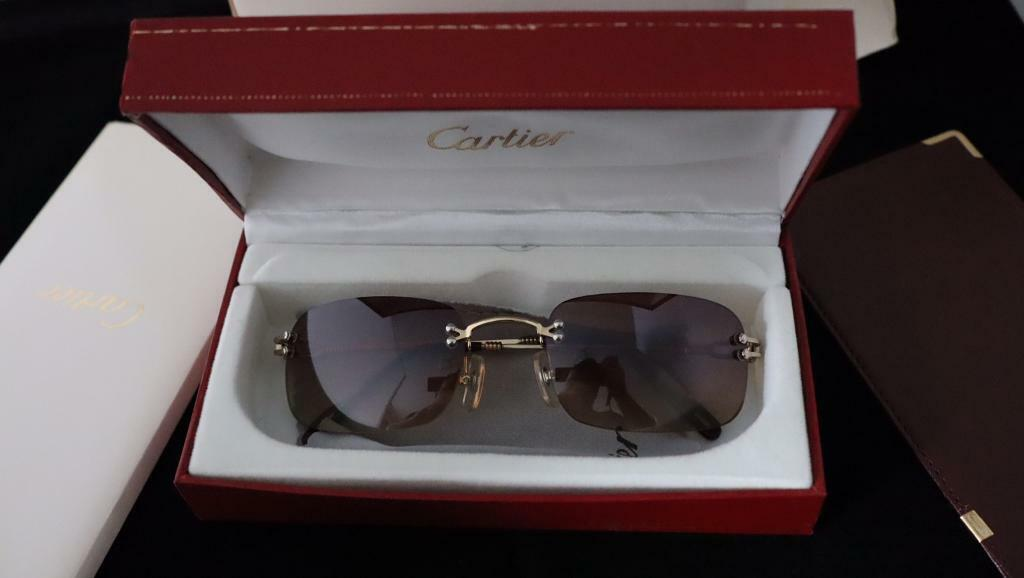 95f51be52382 Cartier sun glasses genuine boxed including book soft case