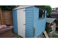 6 by 8 wooden garden shed with internal shelving.