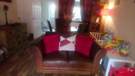 Tan leather two seater and corner sofa