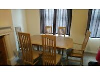 Oak extendable dining table with 6 chairs and corner buffet cabinet