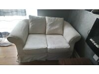 2 seater cream fabric couch