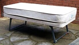 guest bed 174 x 75cm. with mattress. slides under other single beds. In good condition.