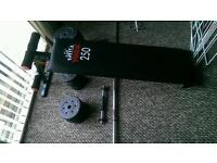 Weights with sit up bench, bar and dumbbells.