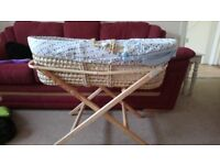 Moses basket with pale blue bedding